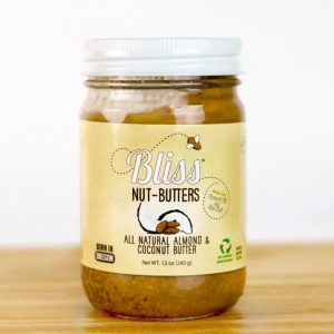 jar of almond & coconut butter on wood surface
