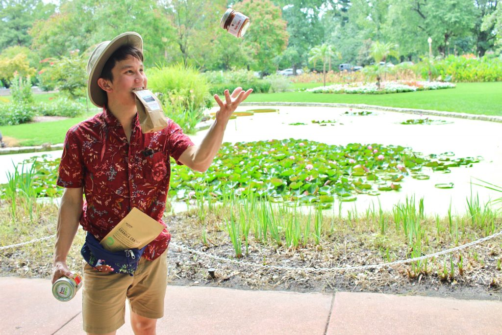 chris with products in front of waterlily pond