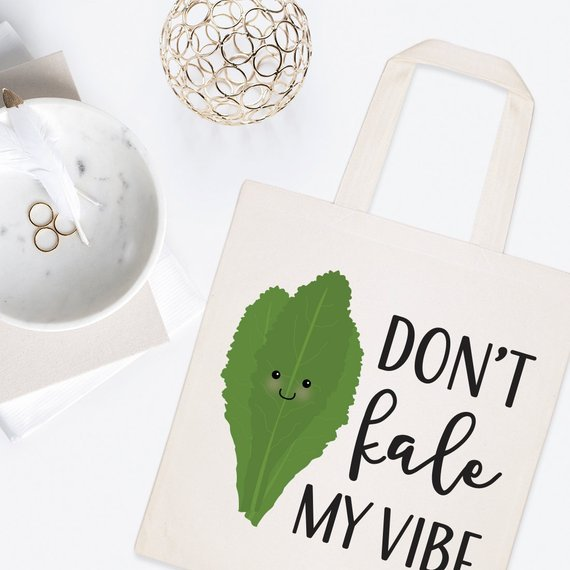 tote bag that says don't kale my vibe with cartoon kale image