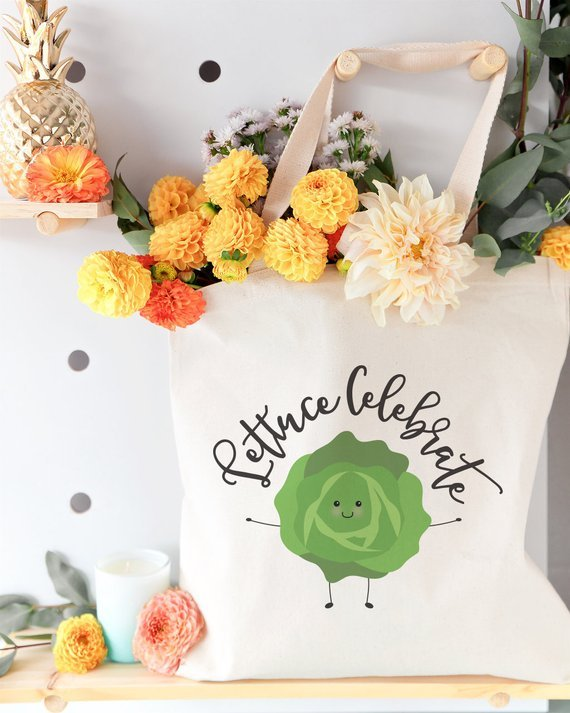 tote bag filled with flowers that says lettuce celebrate with picture of a lettuce head