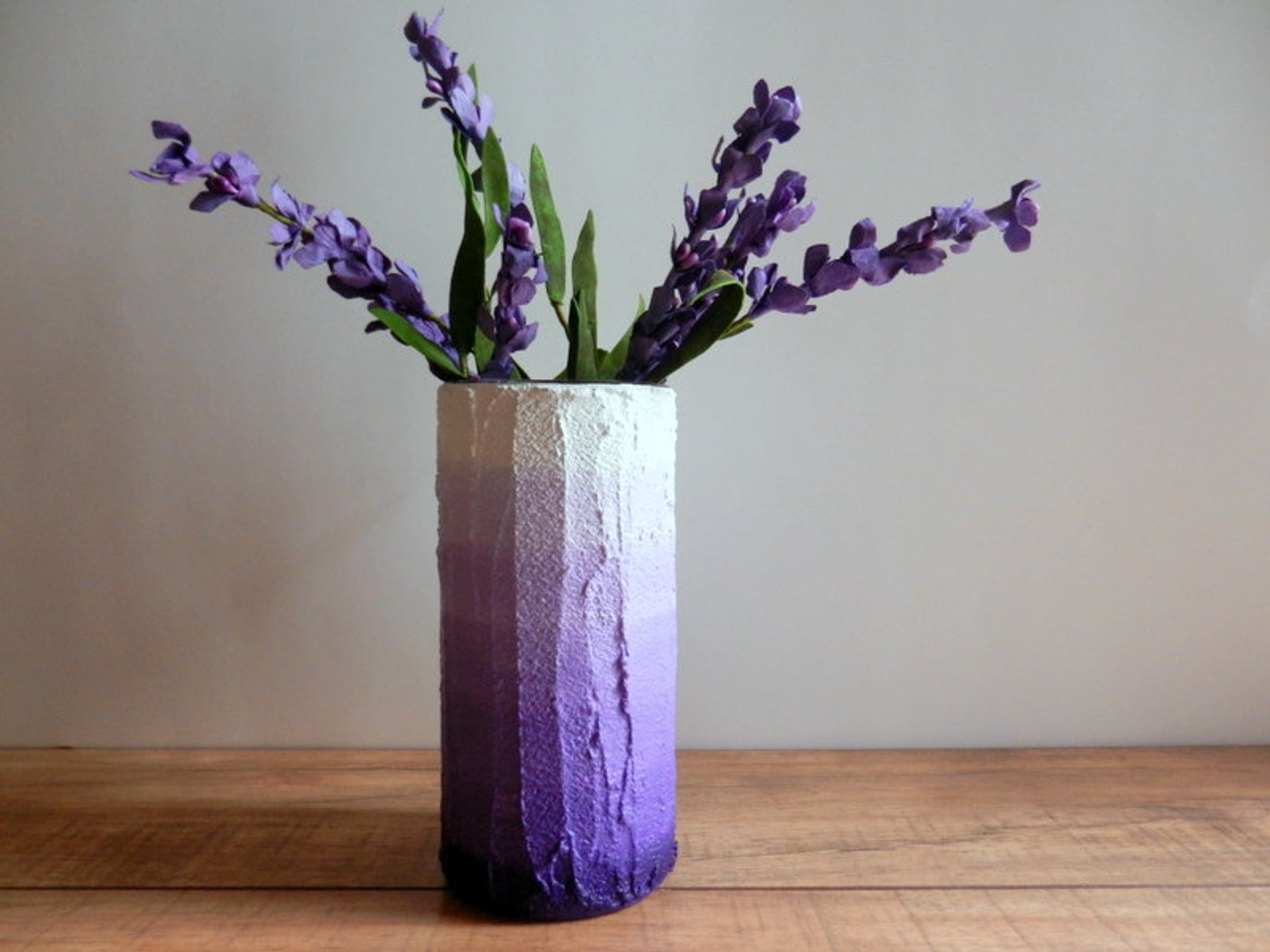 purple ombre vase with flowers in it