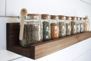 spice jars lined on wooded rack