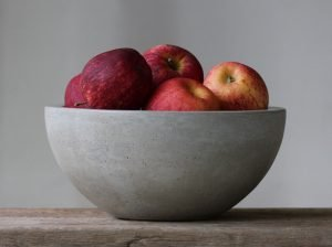 concrete fruit bowl with fruit in it