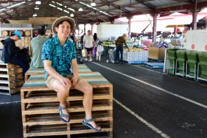 chris sitting on shipping crates at Queen Victoria Market
