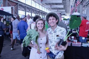 chris and chelsea holding fruits and veggies at Chattanooga Market